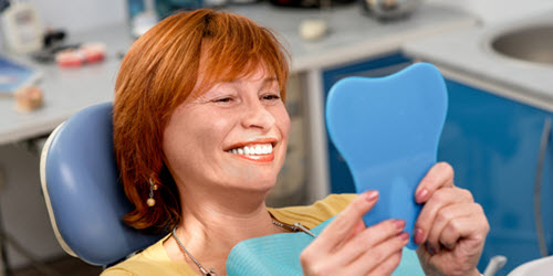 Happy Lady After Dental Implant