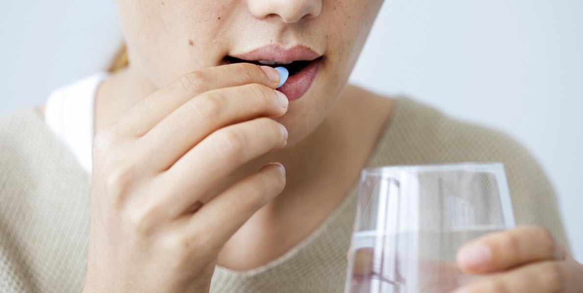 Lady Taking Antibiotics