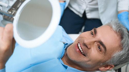 Happy Man After Dental Implant